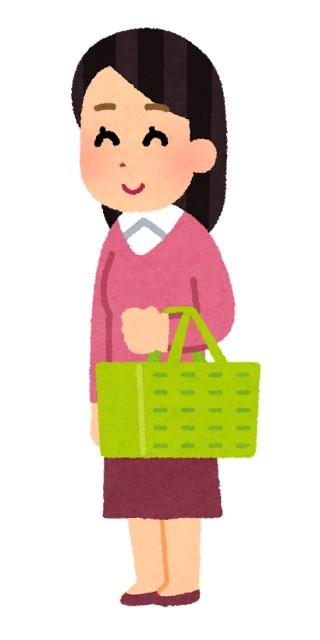 買い物カゴを持つ女性